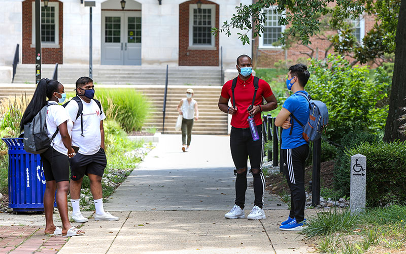 A group of University of Maryland students outside, wearing masks.